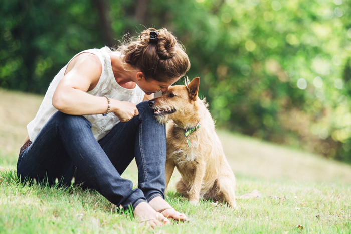 Woman enjoying time with her dog